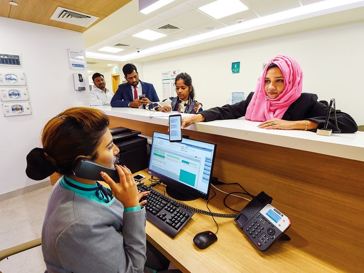 Staff catering to patients during rush-hour at Aster Hospital in Al Qusais