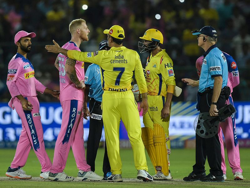 CSK captain M S Dhoni talks to the umpires