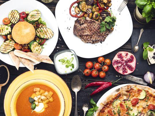 OPN-A-dinner-table,-full-of-food-1555245022435