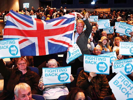 Supporters of The Brexit Party hold placards