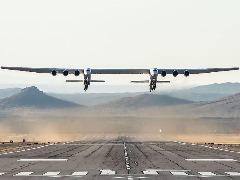 The Stratolaunch plane flying above the California desert