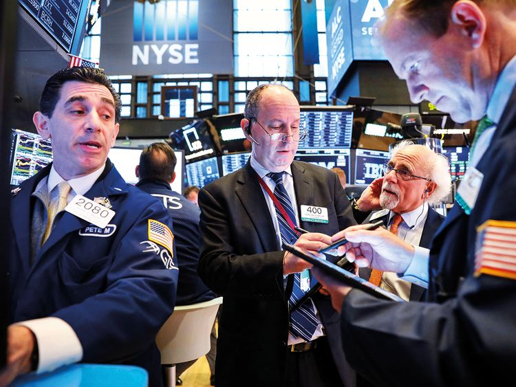 Traders at the New York Stock Exchange 9