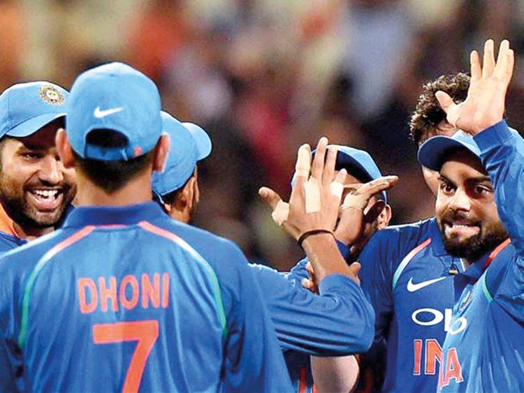 Indian captain Virat Kohli celebrates with teammates