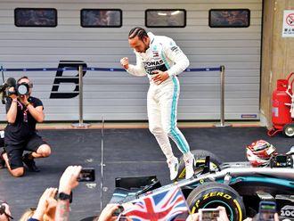 Mercedes' British driver Lewis Hamilton celebrates 7