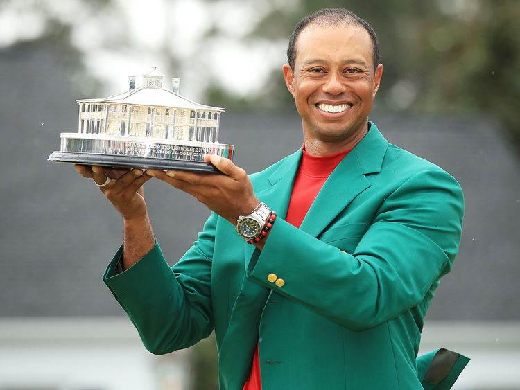 Tiger Woods celebrates with the Masters Trophy