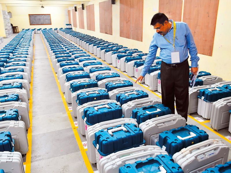 A government official inspects Electronic Voting Machines (EVM)
