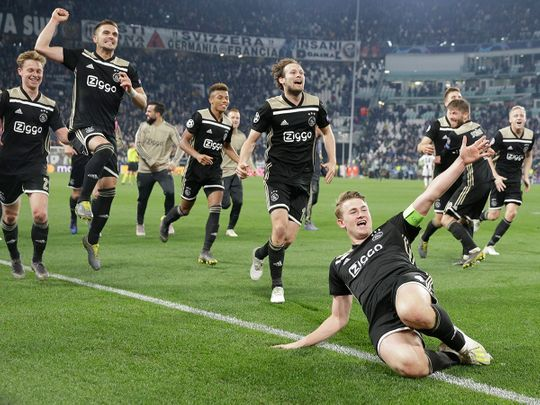Ajax's Matthijs de Ligt and teammates celebrate