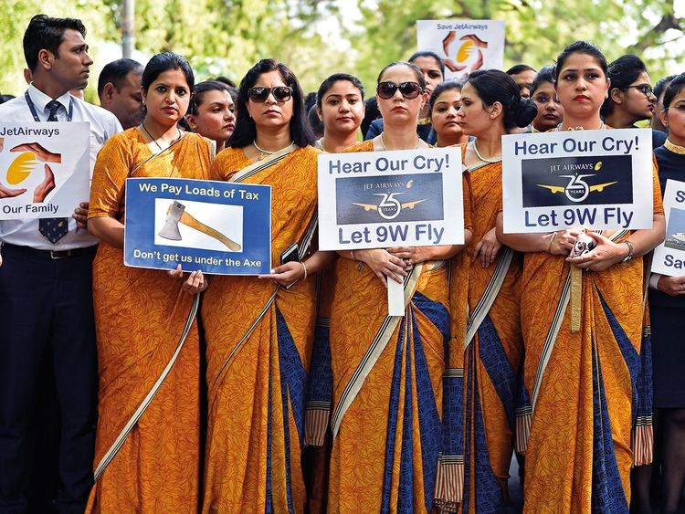 Cabin crew hold placards during a protest organided by Jet Airways employees