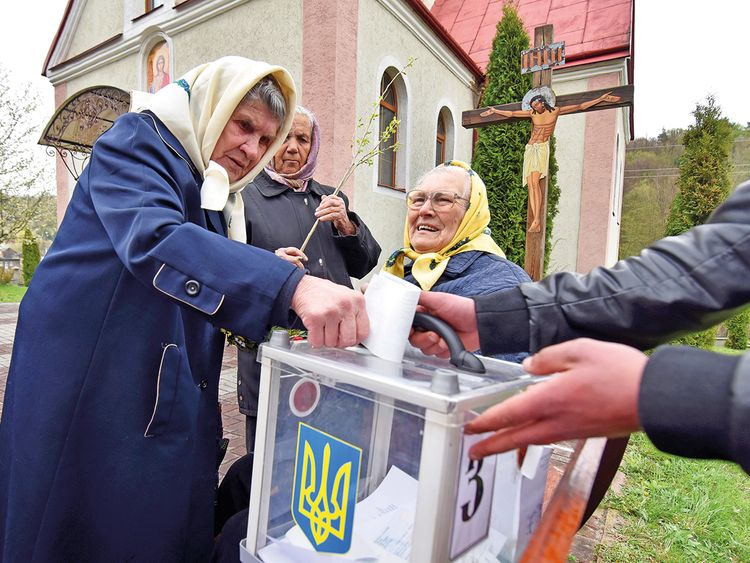 A local resident casts her vote