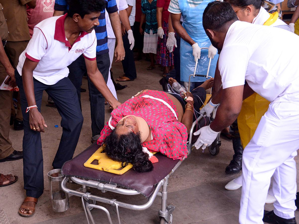 An injured woman lays on a stretcher