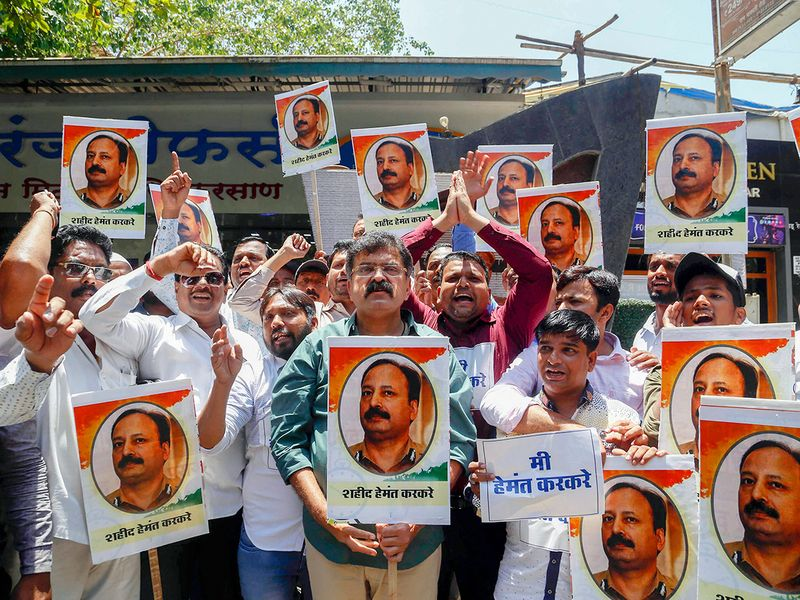 NCP party workers stage a protest