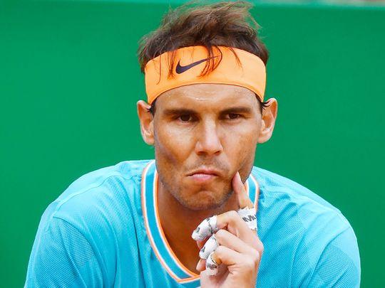 Rafael Nadal reacts