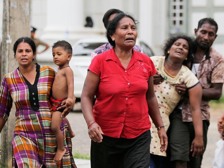 Relatives of a blast victim grieve