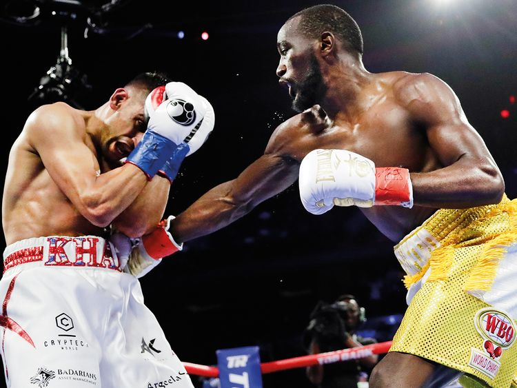 Terence Crawford punches Amir Khan