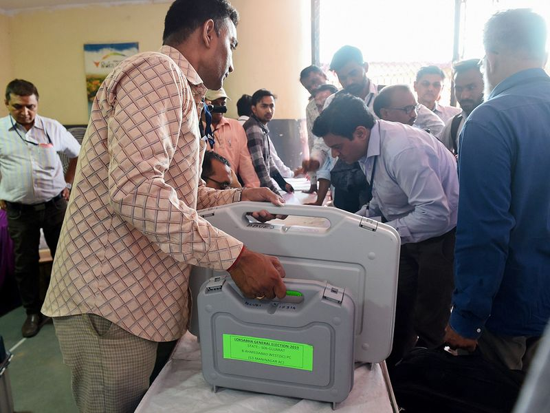 Electoral staff members dispatches Electronic Voting Machines
