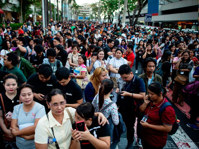 Employees are seen at an open area in Manila