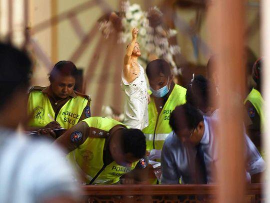 Security personnel inspect inside St. Sebastian's Church in Negombo 20190422