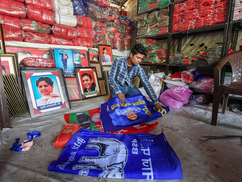 Shopkeepers prepare election campaign materials
