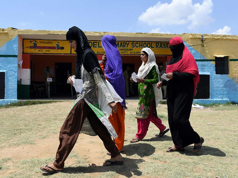 Voters walk to cast their vote