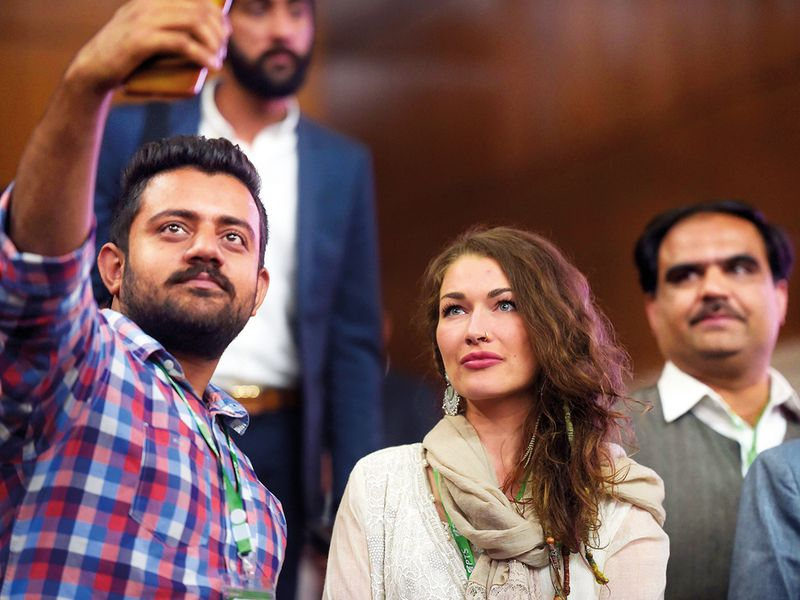 A man takes a selfie with Gabrielle in Islamabad