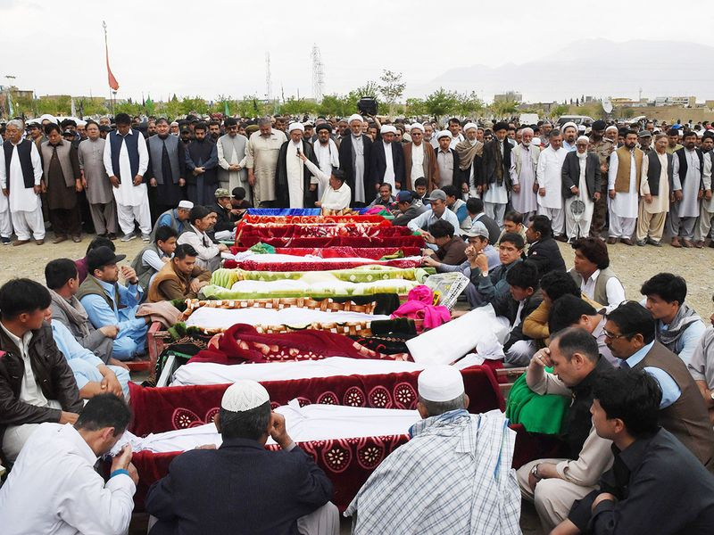 Mourners of the Shia Hazara ethnic minority offer funeral prayers