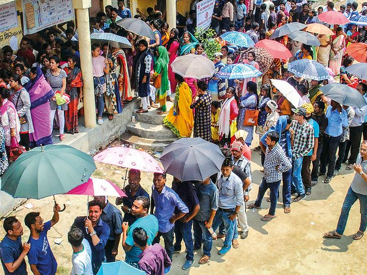 Voters wait in long queues