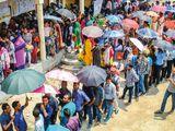 Voters wait in long queues