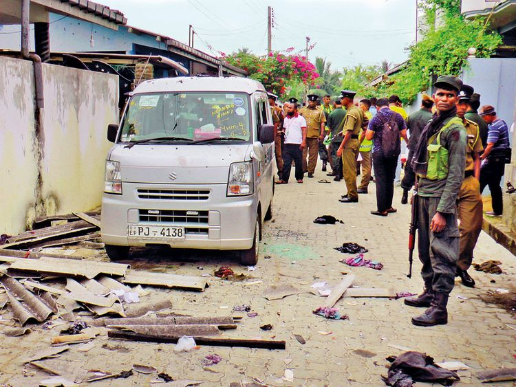 Sri Lankan police and army soldiers secure