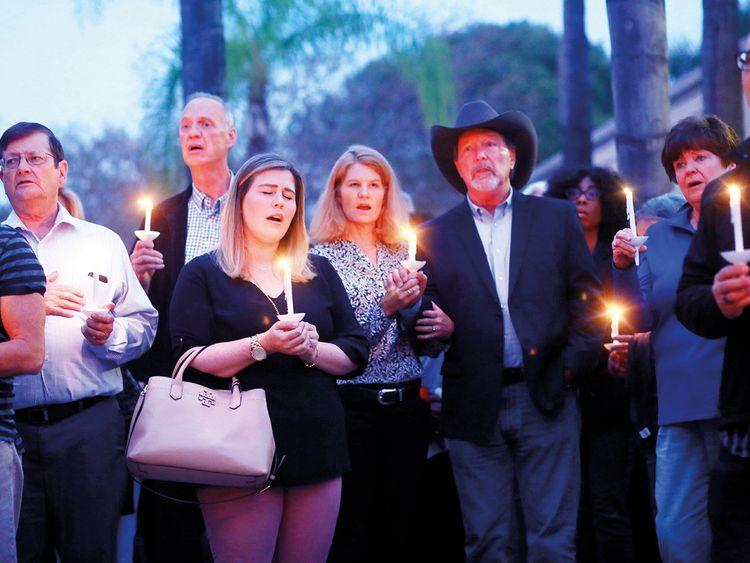 Mourners, including Poway Mayor Steve Vaus