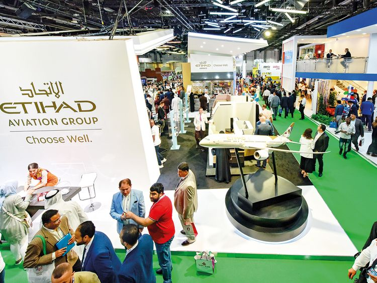 People at Etihad Airways at Arabian Travel Market