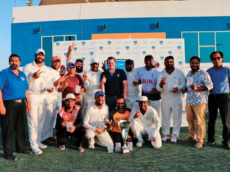 White Hunters team pose with the winners trophy
