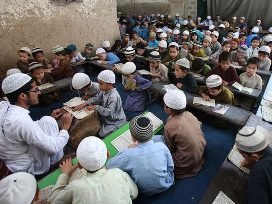 Students attend a religious madrasa