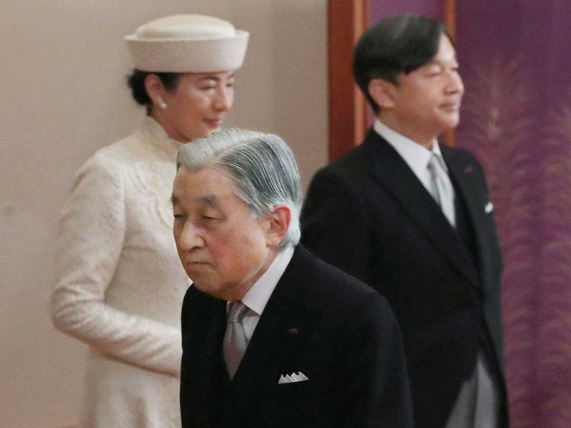 Japan's Emperor Akihito walks 0212
