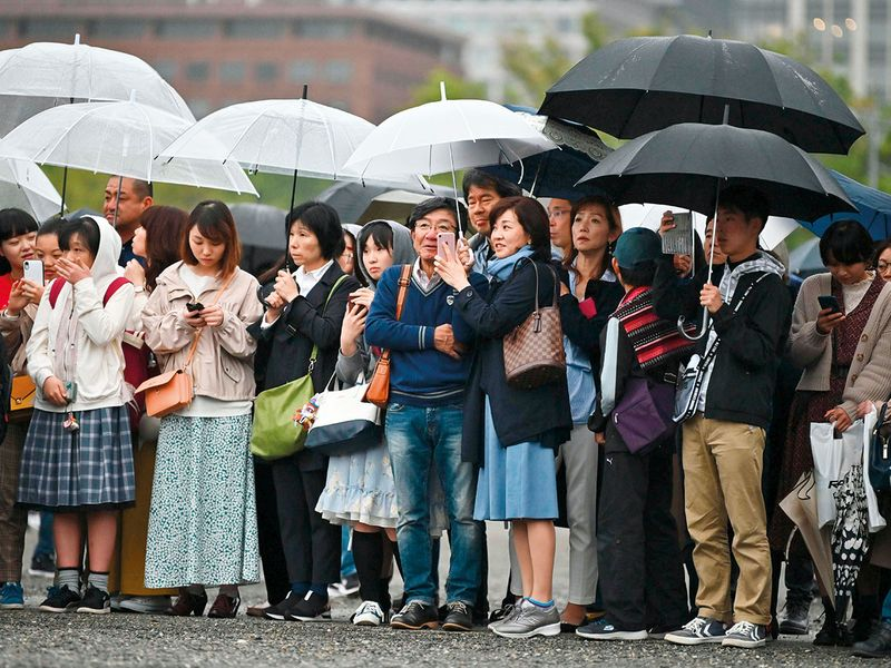 People gather in the rain