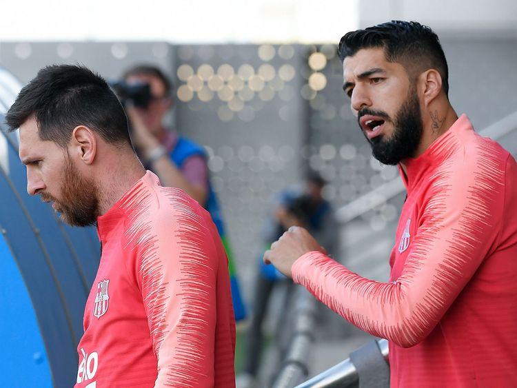 Barcelona's Lionel Messi and Luis Suarez