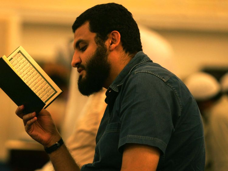OPN_Man_reading_Quran-1556713548485