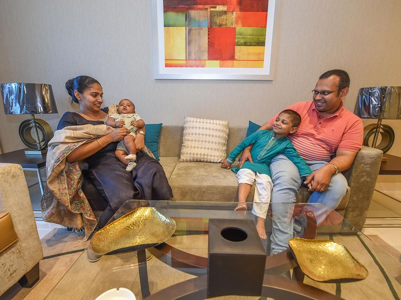 Bobby Varghese with his wife Rosna and children