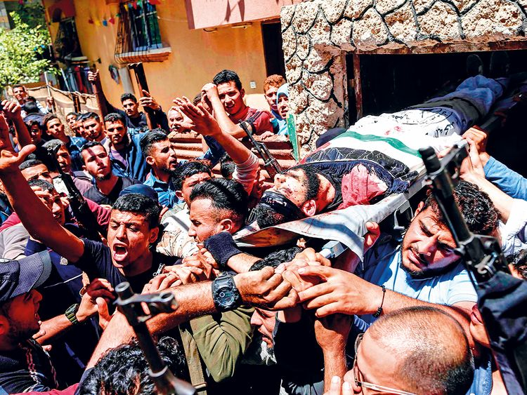 Mourners carry the body of 22-year-old Palestinian Emad Nasser