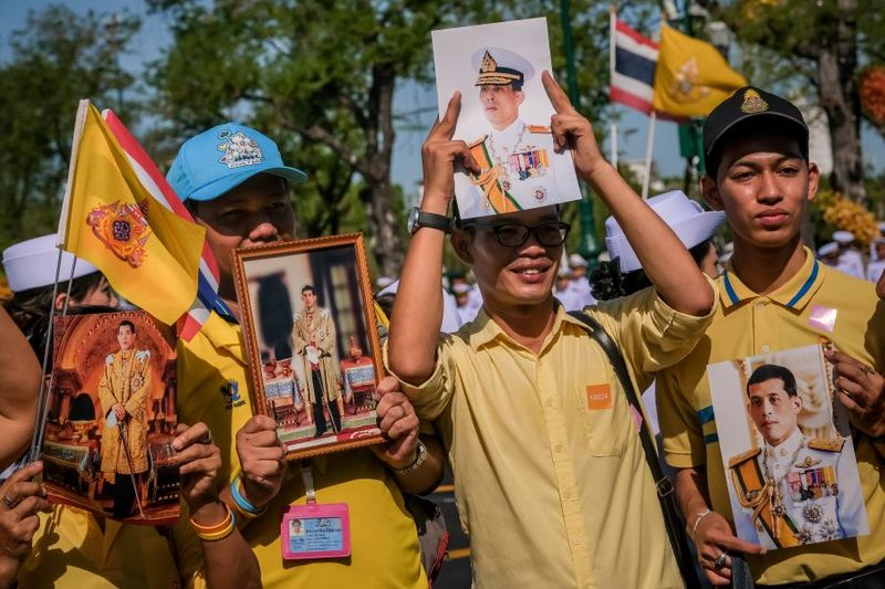 People hold portraits of Thailand's King Maha 012