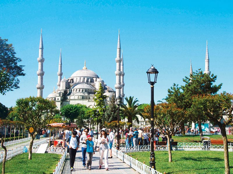 Tourists at the Blue Mosque in Istanbul