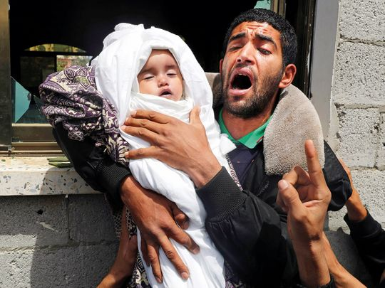 A relative of 14-month old Palestinian baby Seba Abu Arar