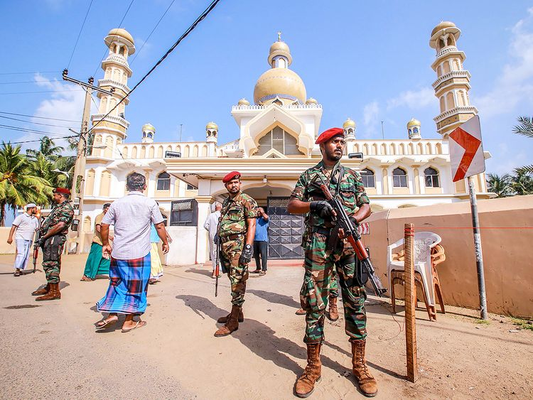 Sri Lankan security personnel stand guard