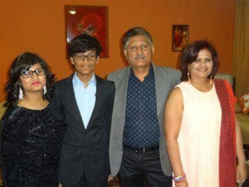 Aman (second from left) with his family