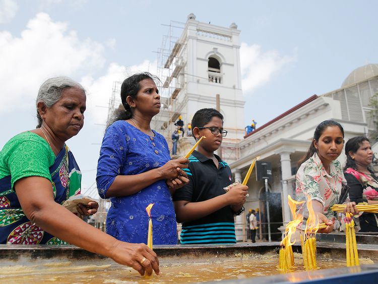 Sri Lankan Catholic devotees light candles