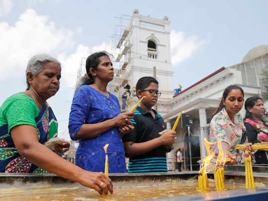 Sri Lankan Catholic devotees light candles