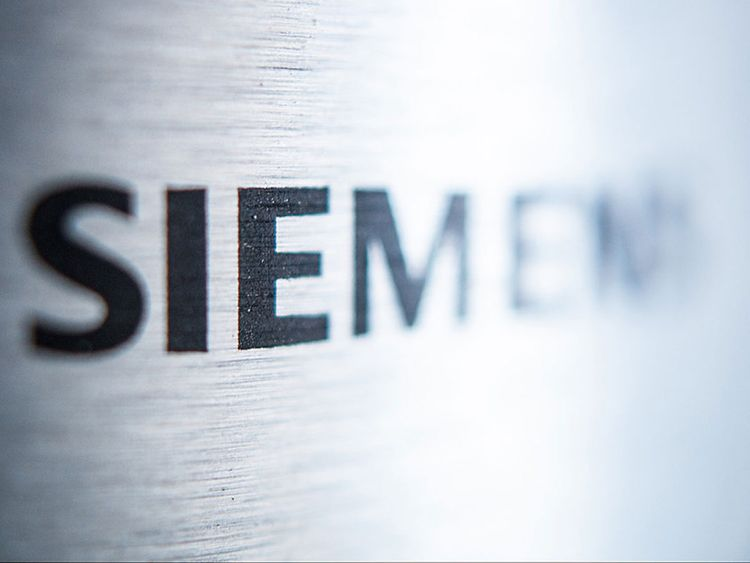 Siemens says it will cut more than 10,000 jobs, and losses
