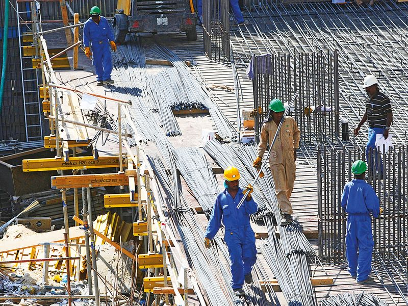 Indian construction workers at a site in Dubai Marina