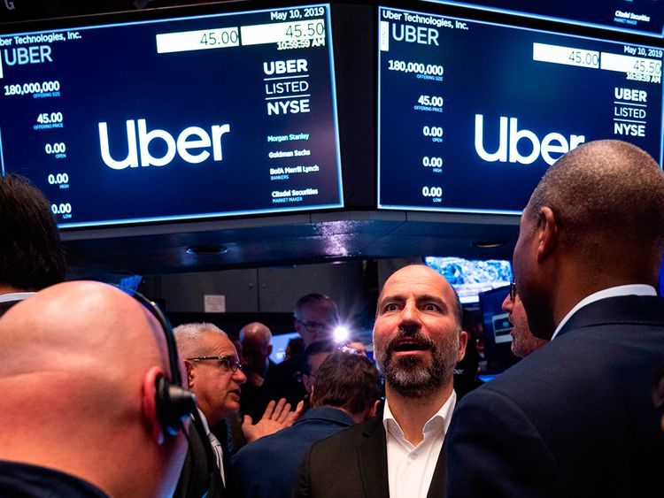 Uber rings NYSE bell, watches stock slide below offering