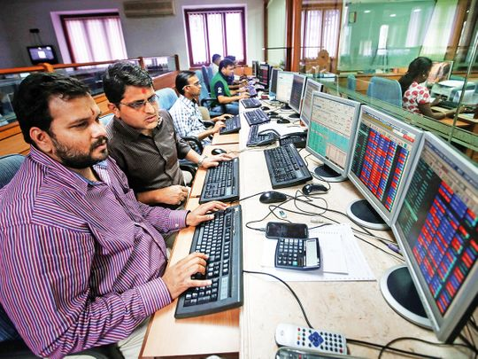 Indian traders work at a brokerage firm in Mumbai.