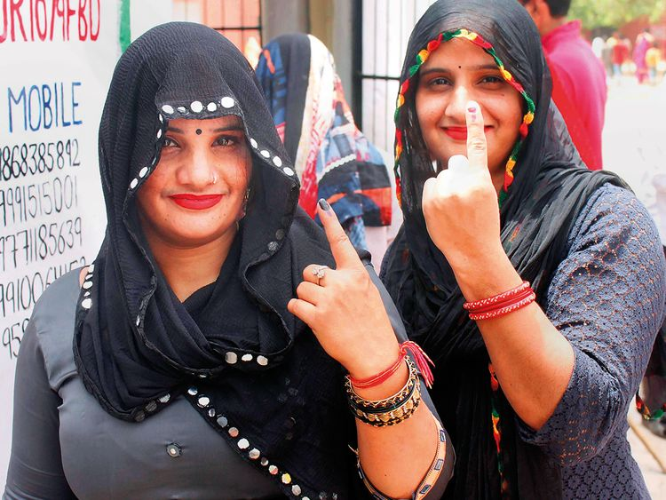 Voters show their fingers marked with indelible ink